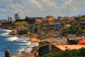 The Puerto Rican capital, San Juan, is fringed by slums like La Perla, pictured above. Photo by Christopher Rose.