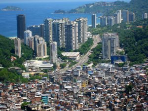 Just like countless cities across Latin America, the favelas of Rocinha, Brazil look out over luxury apartments. Photo by AHLN.